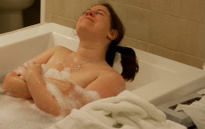 Susanne enjoying the huge bathtub